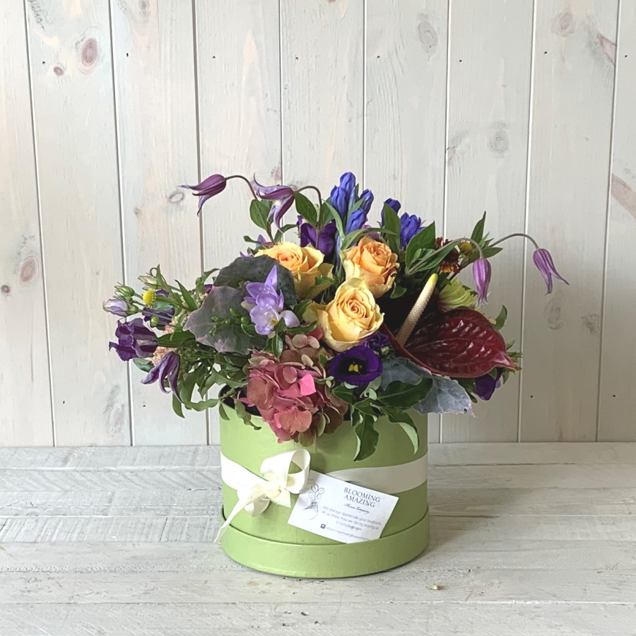 Vibrant Spring Flowers in Hatbox